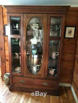 Antique China Cabinet with oval glass door and wood inlay