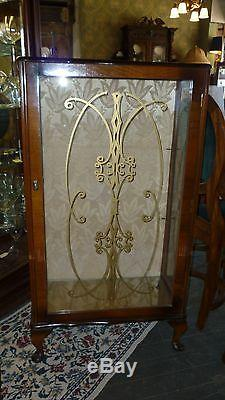 Antique English Curio Cabinet with glass shelves and gold etching on door