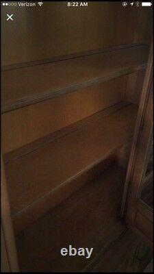 China cabinet, 3 shelves inside glass, 2 drawers, 2 side doors below the glass