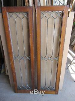 Good PAIR OF LEADED GLASS CABINET DOORS CHESTNUT 28 X 52 ARCHITECTURAL SALVAGE