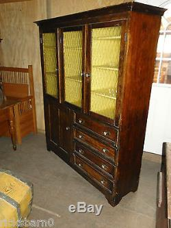 Pine Kitchen Cupboard With Amber Glass Doors